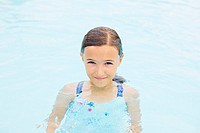 Girl standing in swimming pool.