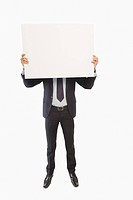 Businessman showing a blank placard