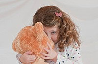 Little girl and teddybear