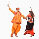 Couple performing dandiya