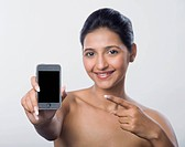 Woman showing a mobile phone and smiling