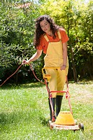Woman lawn mower garden