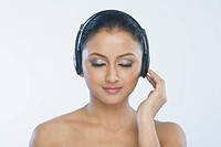 Close_up of a woman listening to headphones