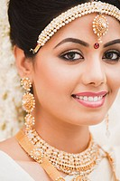 Portrait of a bride in traditional South Indian dress smiling