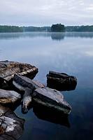 Sweden, Skane, view on lake, rocks on the foreground