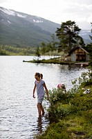 Norway, girl 6_7 stepping into lake