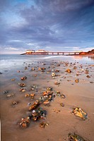 England, Norfolk, Cromer. Stormy light over Cromer Pier shortly before sunset on the North Norfolk Coast.