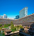 Lake and terrace blocks in the Barbican Estate in the City of London. The Barbican Estate was built as a result of massive damage in the city during t...