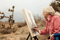 Caucasian woman drawing outdoors