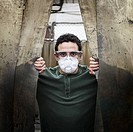 Caucasian worker in protective eyewear and face mask in factory