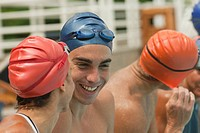 Hispanic swimmers talking together