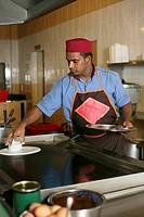 Man preparing thosai