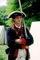 Yorktown Victory Center in Yorktown, near Williamsburg  Interpreter in uniform of Continental Army soldier with musket