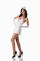 Woman in nurse outfit posing for the camera