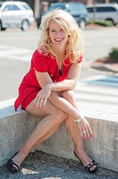 Portrait of a smiling 44 year old blond woman, outdoors