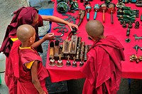 Young monks at souvenir shop outside of the Phyan monastery a day before the Musk dance festival