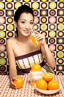 Woman enjoying orange juice