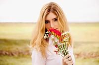 Portrait of a woman smelling flowers