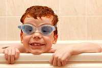 Bath time  Boy wearing goggles in the bath