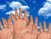 Human hands and the sky. Conceptual image of human hands reaching towards the sky. This image could represent volunteers, or concepts related to enter...