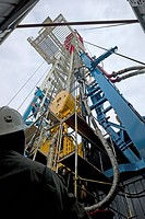 Self_propelled oil drilling rig. Engineers working on an oil drilling rig that is under construction. This rig is capable of moving under its own powe...