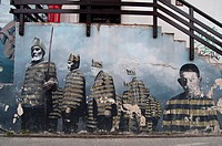 Mural painting representing inmates from the Ushuaia Prison, which was closed in 1947