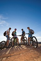 A group mountain biking in Moab, Utah.