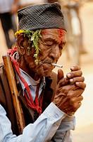 nepalis man smoking , the nepalis , life in kathmandu , kathmandu street life , nepal