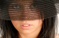Woman looking through transparent brim