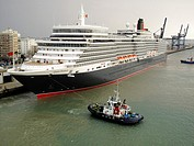 Cruise liner Queen Elizabeth is towed into the port of Cadiz, Spain