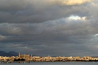 The Port of Palma de Mallorca with the Cathedral of St. Mary at sunset with dramatic clouds, Spain