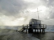 Lifeguard house in bad weather and strong waves, Sylt, Germany