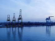 Blue hour, lift cranes in the port of Valencia, Spain