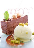 Chocolate marquise dessert with ice cream and pistachio nuts