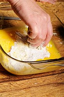 Stock photo of a turkey escalope being dipped into flour