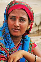 Woman at the ghat by the Ganges River