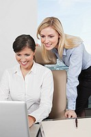 Germany, Frankfurt, Business women using laptop in office