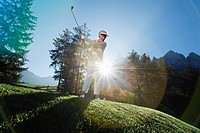 Italy, Kastelruth, Mature woman playing golf on golf course
