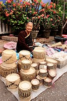 market woman selling hand-make basket, market scenery, city of Luang Prabang, northen of laos, unesco warld heritage.