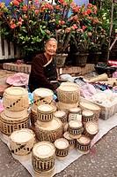 market woman selling hand-make basket, market scenery, city of Luang Prabang, northen of laos, unesco warld heritage.