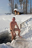 Smiling Man Climbing Out from Ice Hole in Sokka Holiday Resort, Valga County, Estonia