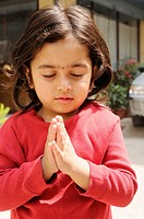 little nepalis girl praying, the nepalis , life in kathmandu , kathmandu street life , Nepal