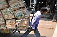 Men transport heavy luggages by man power