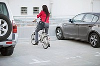 Woman parking a bicycle