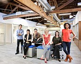 Business people sitting together in office