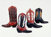 Product shot of four rather flamboyant and highly decorative cowboy boots