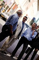 Businessmen talking on a street
