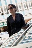 businesswoman crossing a street