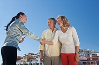 Realestate agent greeting mature couple
