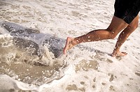 close_up of man running at the waters edge